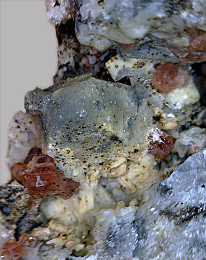 Nepheline and Eudialyte crystals on Hackmanite, Poudrette Quarry, Mont Saint-Hilaire, Rouville RCM, Montérégie, Québec, Canada